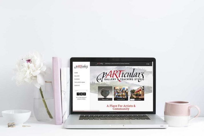 Mockup of Particulars' website on a laptop